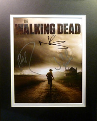 The Walking Dead poster/print, with black & white mat, signed by Michael Rooker, Norman Reedus, and Jon Bernthal.