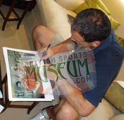 Martin Johnson signs one of the print run that came from this original