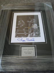 Muhammad Ali and Leon Spinks signed by both.