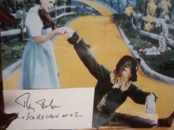 Ray Bolger as the Scarecrow of OZ